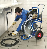 Menlo Park plumbing contractor cleans a drain with a power auger